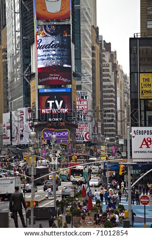 NEW YORK CITY - SEPTEMBER 19: Times Square in New York City, September 19 ,2010. Times Square attracts an estimated 26 million annual visitors each year. - stock photo