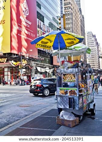NEW YORK CITY - SEPTEMBER 22: Times Square street vendor in New York City, NY on September 22, 2013. - stock photo