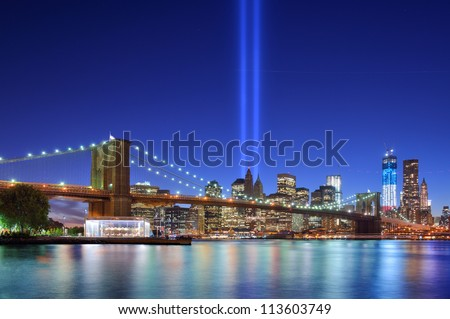 NEW YORK CITY - SEPTEMBER 11: Tribute in Light September 11, 2012 in New York, NY. The installation of 88 searchlights has been displayed annually in remembrance of the September 11, 2001 attacks. - stock photo
