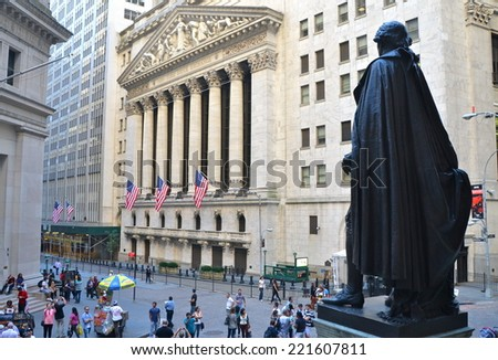 NEW YORK CITY - SEPTEMBER 29, 2014: View from Federal Hall of pedestrians walking along Broad and Wall Street past the New York Stock Exchange, New York City, USA - stock photo