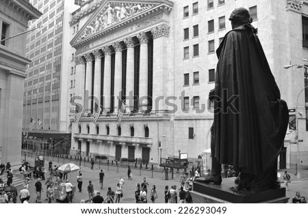 NEW YORK CITY - SEPTEMBER 29, 2014: View from Federal Hall of pedestrians walking along Broad and Wall Street past the New York Stock Exchange, New York City, USA. - stock photo