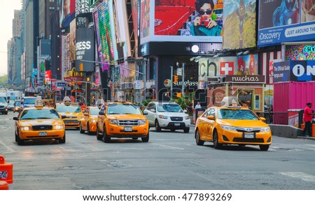 NEW YORK CITY - SEPTEMBER 04: Yellow cabs at Times square on October 4, 2015 in New York City. It's major commercial intersection and neighborhood in Midtown Manhattan