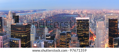 New York City skyline aerial view panorama at dusk with central park and skyscrapers of midtown Manhattan lit by lights. - stock photo