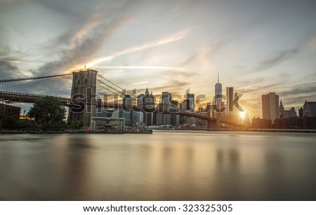 New york city skyline and Brooklyn bridge. long exposure image to improve the artistic side of the city - stock photo