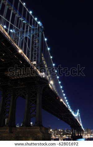 New York City Skyline and Manhattan Bridge At Night - stock photo