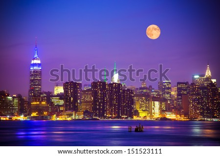 New York City skyline at night with full moon - stock photo