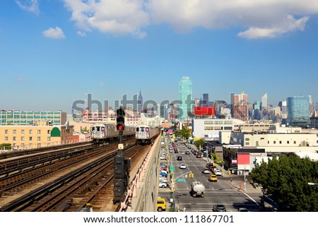 New York City skyline from subway line in Queens - stock photo