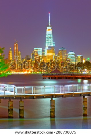 New York City skyline of financial business buildings in Manhattan illuminated at night - stock photo