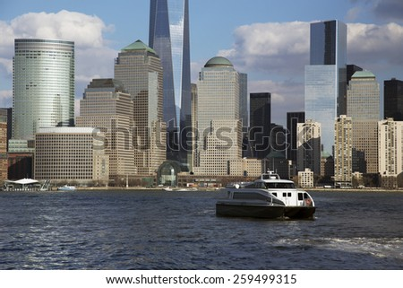 New York City Skyline on water featuring One World Trade Center (1WTC), Freedom Tower, New York City, New York, USA City, New York, USA, 03.20.2014 - stock photo
