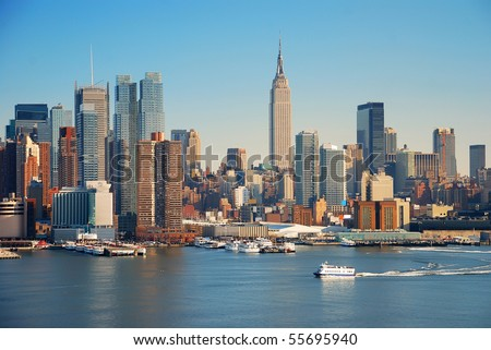 New York City skyline over Hudson river with boat and skyscraper. - stock photo