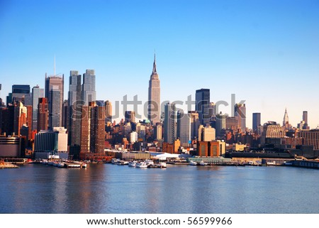 New York City Skyline over Hudson river with boats and skyscrapers.