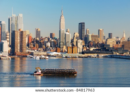 New York City skyline panorama over Hudson river with boat and skyscraper. - stock photo
