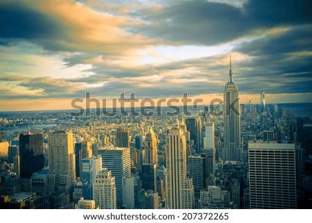 New York City skyline under dramatic evening sky - stock photo
