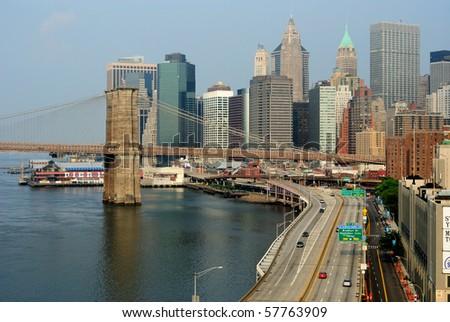 New York City skyline with Brooklyn Bridge and FDR Drive. - stock photo