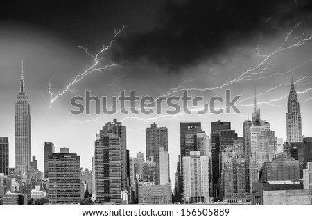 New York. City skyline with major skyscrapers during a storm with lightning. - stock photo