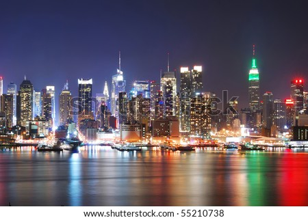 New York City Skyline with Times Square and Empire State Building at night. - stock photo