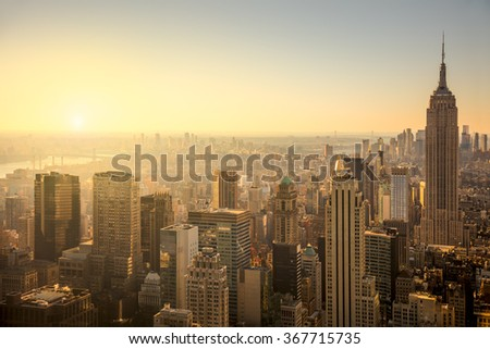 New York City skyline with urban skyscrapers at gentle sunrise, famous Manhattan view, USA - stock photo