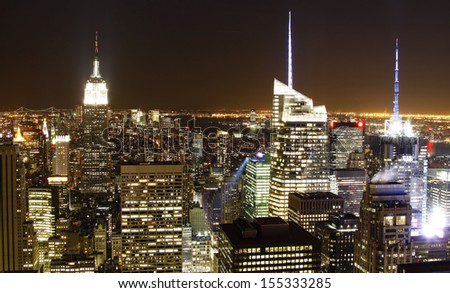 New York City skyline with urban skyscrapers at night.  - stock photo