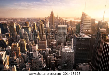 New York City skyline with urban skyscrapers at sunset, USA. - stock photo