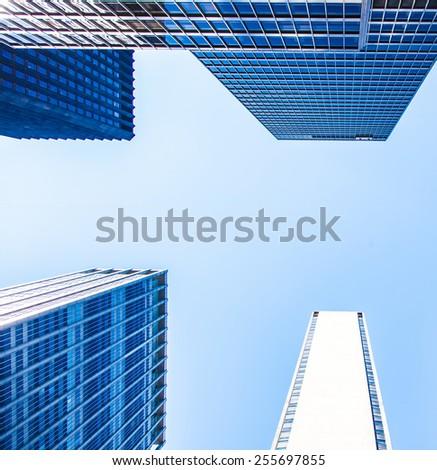 New York City skyscraper in front of bright blue sky - stock photo