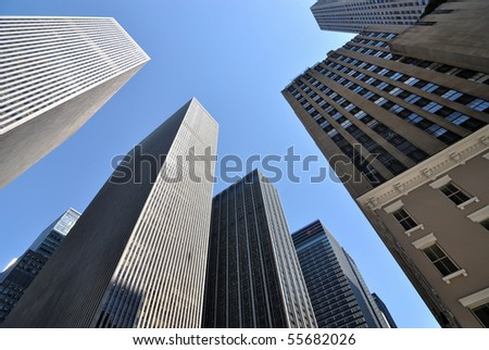 New York City skyscrapers bask in sunlight. - stock photo