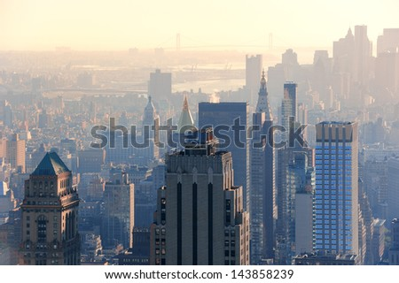 New York City skyscrapers in midtown Manhattan aerial panorama view at sunset. - stock photo