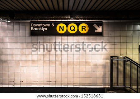 New York City subway with sign - stock photo
