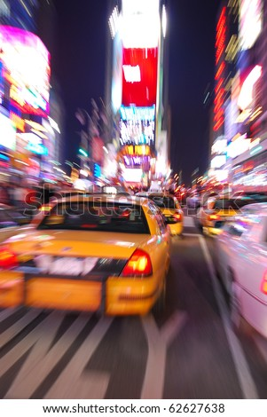 New York City Times Square with Yellow Cab and busy traffic. - stock photo