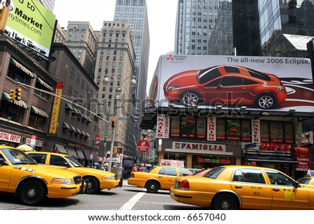 new york city - times square - yellow cars - stock photo