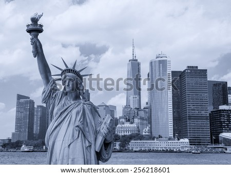 New York City tourism concept. Statue of Liberty with Lower Manhattan skyline. - stock photo
