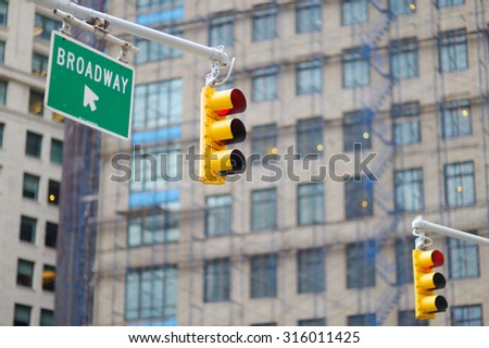 New York city traffic lights with skyscrapers on background  - stock photo