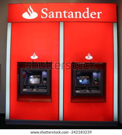 NEW YORK CITY - TUESDAY, DEC. 30, 2014: A pair of Santander Bank ATM. Santander Consumer USA Inc is wholly owned by the Spanish Santander Group. - stock photo