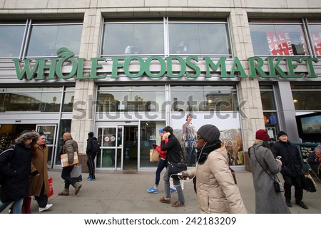 NEW YORK CITY - TUESDAY, DEC. 30, 2014: Pedestrians walk past a Whole Foods supermarket. Whole Foods Market, Inc. specializes in natural and organic foods.