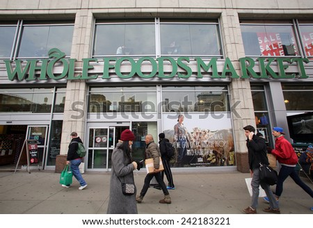 NEW YORK CITY - TUESDAY, DEC. 30, 2014: Pedestrians walk past a Whole Foods supermarket. Whole Foods Market, Inc. specializes in natural and organic foods. - stock photo