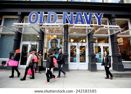 NEW YORK CITY - TUESDAY, DEC. 30, 2014: Pedestrians walk past an Old Navy store. Old Navy is a clothing and accessories retailer owned by Gap Inc. - stock photo