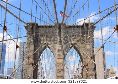 New York City, United States - famous Brooklyn Bridge with US flag. - stock photo