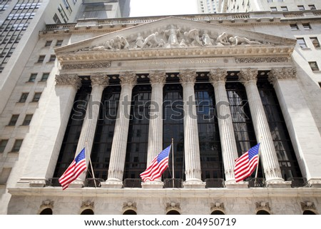 New York City, United States - July 10, 2014: The New York Stock Exchange located on Wall Street in the financial district in lower Manhattan in New York City. on July 10, 2014  - stock photo