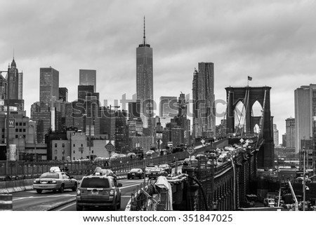 New York City, United States of America - March 25: Traffic on Brooklyn bridge and New York City Manhattan downtown skyline at dusk with skyscrapers over East River panorama on March 25, 2015. - stock photo