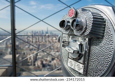 NEW YORK CITY, USA APRIL 25:  Coin-operated binoculars on the observation deck at Empire State Building on April 25, 2014 in NYC. ESB was the tallest building in the world between 1931 -1970.  - stock photo