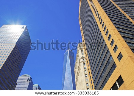 NEW YORK CITY, USA - APRIL 25, 2015: Freedom Tower in Lower Manhattan, NYC, USA. Sunlight reflection spot flare picturesque view. One World Trade Center is tallest building in the Western Hemisphere - stock photo
