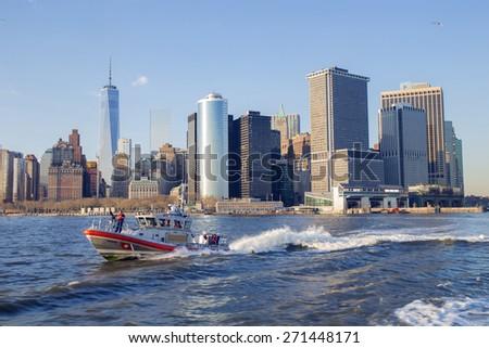 NEW YORK CITY, USA - APRIL 19: U.S. Coast Guard boat patrolling the Hudson River bay. April 19, 2015 in New York City, USA - stock photo