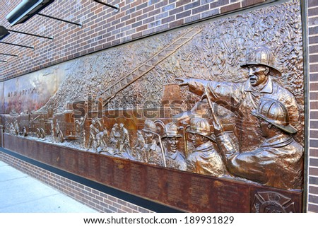 NEW YORK CITY, USA - April 27, 2014: View of the FDNY Memorial Wall for victims of the 2001 terrorist attacks at Engine 10 Ladder 10 across the street from Ground Zero in Lower Manhattan.  - stock photo