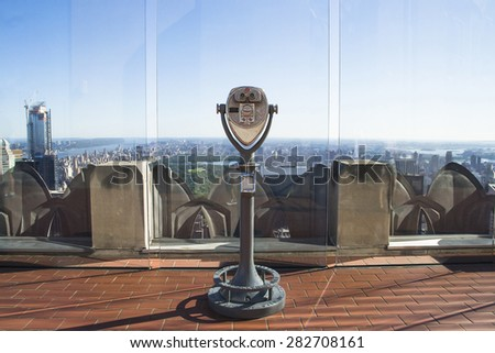 NEW YORK CITY,USA-AUGUST 5,2013:binoculars on rockefeller center c with the city of New York from the top - stock photo