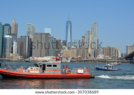 New York City, USA - August 16, 2015: FDNY and NYPD boats responding to an emergency on the East River in New York City. - stock photo