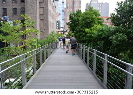 New York City, USA - August 23, 2015: People walking along a path on the High Line on the Lower West Side in New York City. - stock photo