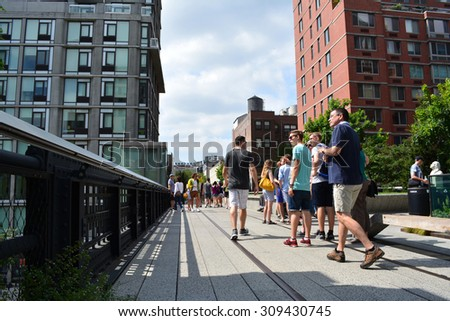 New York City, USA - August 23, 2015: People walking along a path on the High Line on the Lower West Side in New York City.