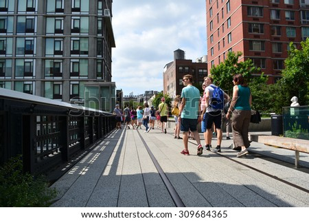 New York City, USA - August 23, 2015: People walking along a path on the High Line on the  West Side in New York City. - stock photo