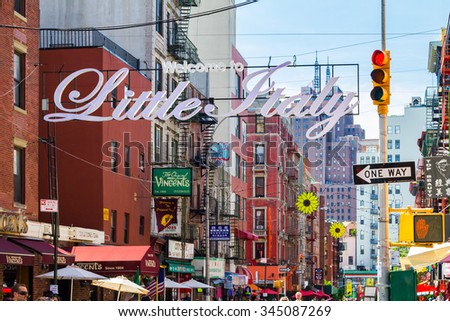 NEW YORK CITY, USA - AUGUST 21, 2015: The busy streets of Little Italy are crowded with tourists during an Italian summer street festival in Manhattan, New York City. - stock photo