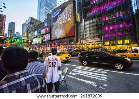 NEW YORK CITY,USA-AUGUST 2,2013:time square in the night is full of advertising signs,billboard, traffic and people walking by shopping or sightseeing. - stock photo