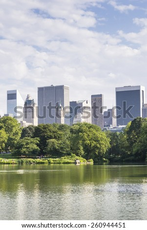 NEW YORK CITY,USA-AUGUST 3,2013:view of some skyscrapers from one of the many lakes found in central park in new york.people come here to relax and practice outdoor sports